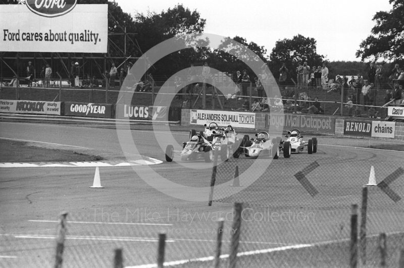 Formula Ford cars battle it out at Woodcote, Tourist Trophy meeting, Silverstone, 1984.