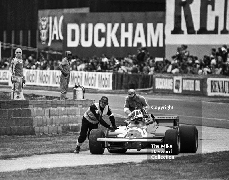 Didier Pironi gets a push back to the pits during qualifying in his Ferrari 126CK, Silverstone, British Grand Prix 1981.