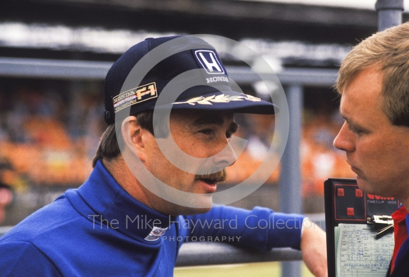 Nigel Mansell and a race engineer in the pits, Silverstone, 1987 British Grand Prix.