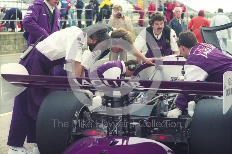 Mechanics working on a Jaguar XJR-11, Shell BDRC Empire Trophy, Round 3 of the World Sports Prototype Championship, Silverstone, 1990.