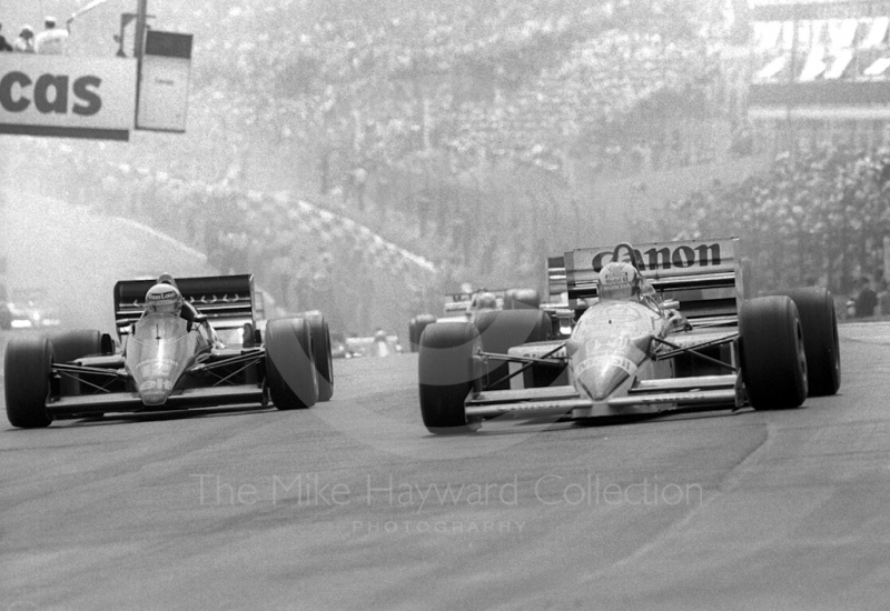 Nigel Mansell, Williams Honda FW11, and Ayrton Senna, JPS Lotus 98T, at Paddock Bend, Brands Hatch, 1986 British Grand Prix.