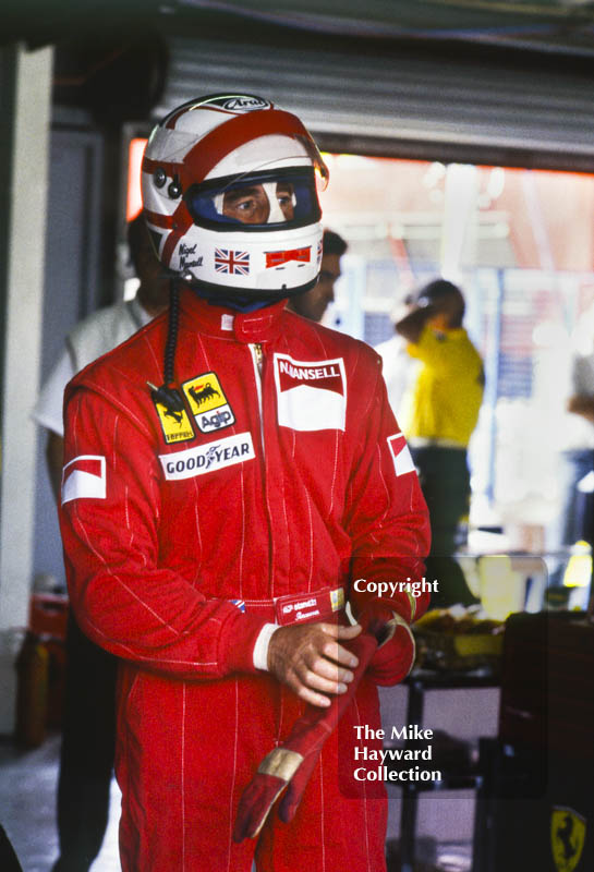 Nigel Mansell in the pits during practice for the British Grand Prix, Silverstone, 1989.