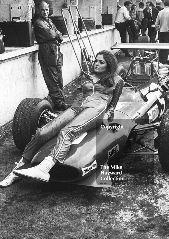 A model poses on the Ferrari 312 V12 of Chris Amon in the pit lane during practice, British Grand Prix, Brands Hatch, 1968