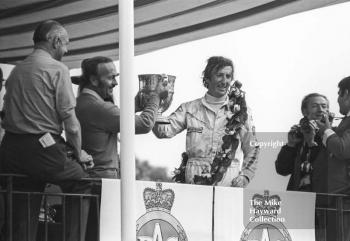 Jochen Rindt holds the trophy with Colin Chapman, British Grand Prix, Brands Hatch, 1970