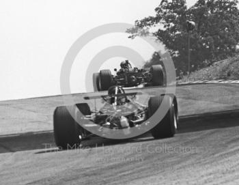 Piers Courage, BRM P126 V12, exits South Bank Bend ahead of Jochen Rindt, Brabham BT26, British Grand Prix, Brands Hatch, 1968.