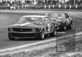 Winner Brian Muir, Wiggins Teape Chevrolet Camaro, chases Frank Gardner, Motor Racing Research Ford Mustang Boss, out of Copse Corner, Silverstone Martini Trophy meeting 1970.