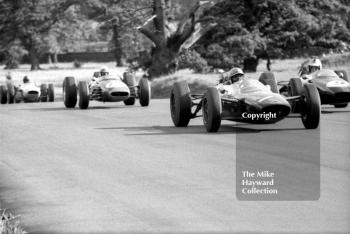 Denny Hulme, Brabham BT16, glances over at John Surtees, Lola T60, as they battle for the lead, Oulton Park Gold Cup, 1965
