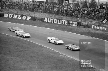 First lap at Paddock Hill bend, BOAC 500, Brands Hatch, 1968. From the front, the cars and drivers are as folllows.<br />