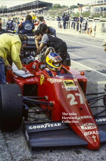 Michele Alboreto, Ferrari 156/85, in the pits at Brands Hatch, 1985 European Grand Prix.