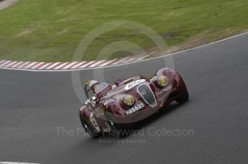 John Chisholm, 1950 Jaguar XK120, reg no HAS 623, BRDC Historic Sports Car Championship Race, Oulton Park Gold Cup meeting 2004.