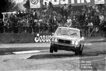 Jean-Pierre Aux on two wheels with his Mazda RX3, Britax Production Saloon Car Race, European F2 Championship meeting, Silverstone, August 31 1975.