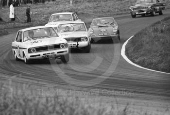 Roger Clark, Team Surtees Lotus Cortina, UVX 565E, leads Jacky Ickx, Team Lotus Cortina, CTC 24E, Vic Elford, Porsche 911, GVB 911D, and Graham Hill, Team Lotus Cortina, CTC 14E, at Cascades Bend, Oulton Park Gold Cup meeting, 1967.