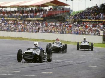 A trio of V16 BRMs howl through Woodcote during a demonstration, British Grand Prix, Silverstone, 1987