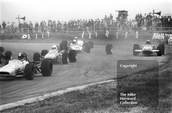 A stray wheel causes chaos at Copse Corner. Pictured are Ray Allen, EMC, John Collings, Peter Deal and Ken Bailey, Martini International Trophy Formula 3 race, Silverstone, 1970.