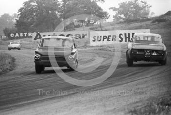Geoff Breakell, Alfa Romeo GTA, LWY 39D, heading for 5th place in Class A, leads a Lotus Cortina out of Cascades, Oulton Park Gold Cup meeting, 1967.