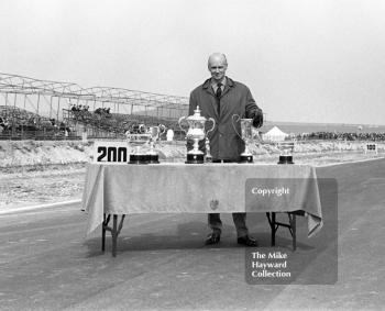 BARC president Earl Howe with the race trophies at the start of the meeting, Thruxton Easter Monday F2 International, 1968.