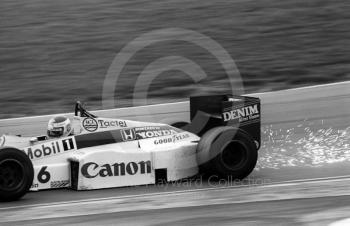 Sparks fly as Keke Rosberg, Williams FW10, exits Paddock Bend, Brands Hatch, 1985 European Grand Prix.