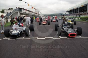 Geoff Farmer, Rob Walker Lotus 49B, and Paul Ingram, BRM P126, line up for the Glover Trophy, Goodwood Revival, 1999