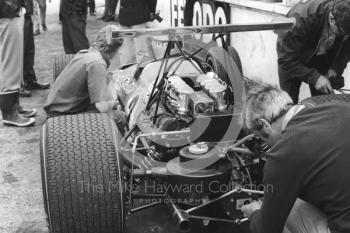 The McLaren Ford M7A driven by Bruce McLaren receives attention during practice for the 1968 British Grand Prix at Brands Hatch.