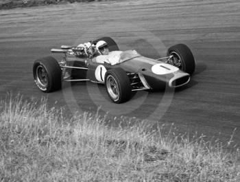 Jack Brabham, Repco Brabham V8 BT24/1, at Esso Bend on his way to winning the Oulton Park Gold Cup 1967.