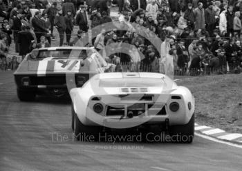 Winning JW Ford GT40 of Jacky Ickx and Brian Redman follows the Julian Sutton/Andrew Hedges 13th place Lotus 47 round Clearways, BOAC 500, Brands Hatch, 1968