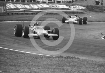 Graham Hill, Lotus Cosworth V8 49B R5, and team mate Jack Oliver at South Bank Bend, British Grand Prix, Brands Hatch, 1968.