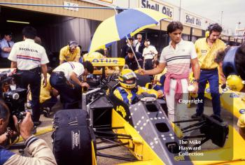 Ayrton Senna, Camel Lotus 99T, in the pits during practice for the 1987 British Grand Prix, Silverstone.