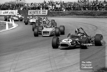 David Purley, LEC Brabham BT28, leads the pack at Copse Corner, followed by Barrie Maskell, Chevron B18, GKN Forgings Trophy, International Trophy meeting, Silverstone, 1971.