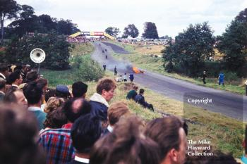 Motorcycle on fire at Knickerbrook, Oulton Park, 1963.