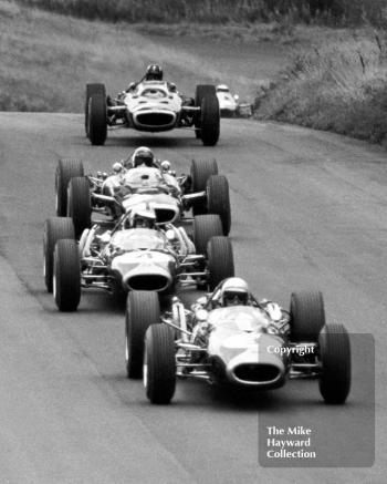 Jack Brabham, Repco Brabham BT19, Denny Hulme, BT20, Jackie Stewart BRM P83 H16, Graham Hill, BRM P83 H16; and Jim Clark, Lotus Climax 33, Oulton Park Gold Cup 1966.