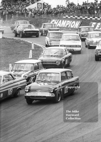 First lap at Paddock Bend with Chris Craft, Broadspeed Ford Anglia leading John Rhodes, Cooper Car Company Mini Cooper S, John Fitzpatrick, Broadspeed Ford Anglia, Brian Robinson, Lotus Cortina, Race of Champions, Brands Hatch, 1968