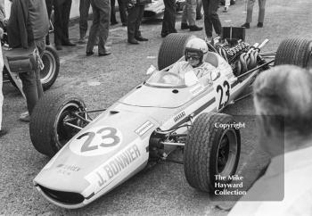 Bruce McLaren tries the McLaren BRM of Jo Bonnier during practice for the 1968 British Grand Prix at Brands Hatch.