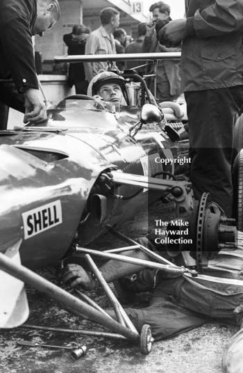 Chris Amon in the pits with his Ferrari 312 0007 V12 during practice for the 1968 British Grand Prix at Brands Hatch.