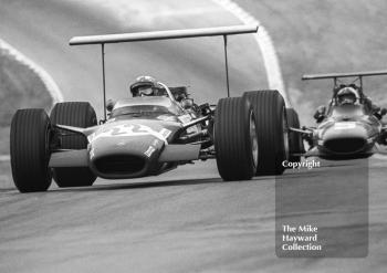 Race winner Jo Siffert, Rob Walker Lotus 49, leads Chris Amon, Ferrari 312 V12, into Druids Hairpin during their long duel for the lead at Brands Hatch, 1968 British Grand Prix.