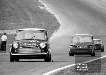 Bill Shaw, Mini Cooper S (reg no COE 456C), leads Tony Lanfranchi, Fraser Hillman Imp, and B Thomson, Ford Mustang, up Pilgrim's Rise, British Touring Car Championship Race, Guards International meeting, Brands Hatch 1967.