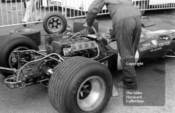 A mechanic works on Jack Oliver's Herts and Essex Aero Club Lotus 48 at the Thruxton Easter Monday F2 International meeting, 1968.