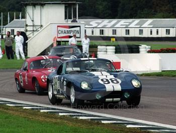 A Shelby Cobra leads Robin Longdon's Lotus Elite out of the chicane, Goodwood Revival, 1999