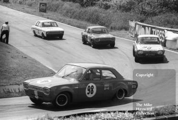 Barry Pearson, Ford Escort, followed by Pat Mannion (PJN 232G) and Willy Kay (Ford Escorts), and Brian Robinson, Lotus Cortina, British Saloon Car Championship race, BRSCC Guards 4,000 Guineas International meeting, Mallory Park, 1969.