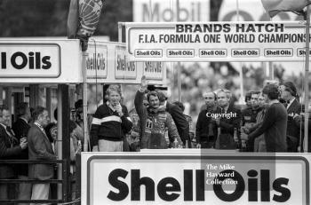 Nigel Mansell celebrates his first race win with Ayrton Senna and Frank Williams, Brands Hatch, 1985 European Grand Prix.