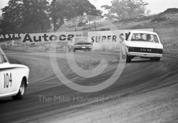 Graham Hill, Team Lotus Cortina, CTC 14E, chases a Ford Falcon out of Cascades followed by the Lotus Cortina of William Vaughan, Oulton Park Gold Cup meeting, 1967.