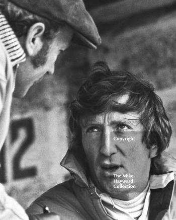 Jochen Rindt deep in conversation with team boss Colin Chapman before his second place finish in a Lotus 49C at the Race of Champions, Brands Hatch, 1970.