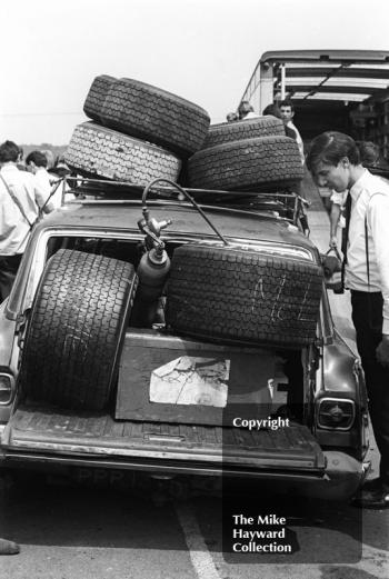A spectator marvels at the size of racing tyres in the paddock, Brands Hatch, 1968 Grand Prix.