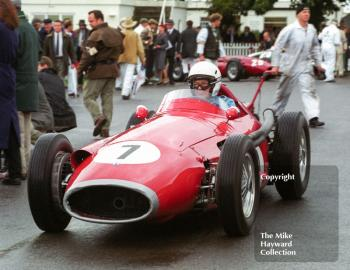 Stirling Moss leaves the paddock in a Maserati 250F for the Richmond and Gordon Trophies, Goodwood Revival, 1999.