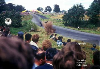 Motorcycle hitting the bank at Knickerbrook, Oulton Park, 1963.