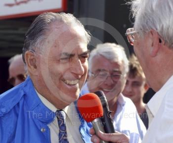Jack Brabham being interviewed in the pit lane, Oulton Park Gold Cup, 2002