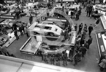 An overall view of the International Racing Car Show at Olympia in 1971, showing the Lola Cars stand.