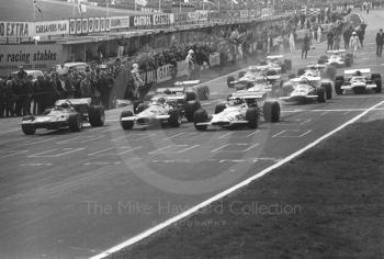 Jackie Stewart, Tyrrell March-Ford 701, Jack Brabham, Brabham BT33, and Jack Oliver, Yardley BRM P153 V12, on the front of the grid, Race of Champions, Brands Hatch, 1970.
