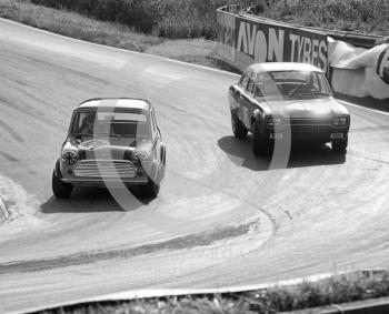 Gordon Spice, Britax Cooper Downton Mini Cooper S, and Chris Craft, Team Broadspeed Ford Escort (XOO 341F), Shaw's Hairpin, British Saloon Car Championship race, BRSCC Guards 4,000 Guineas International meeting, Mallory Park, 1969.