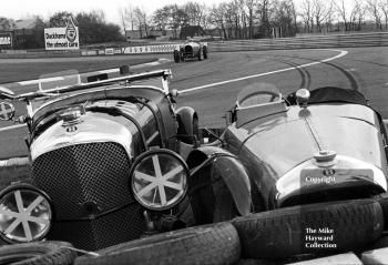 The 1928 Bentley of S Judd parked beside T C Llewellyn's 1929 Bentley at the chicane, VSCC Donington May 1979