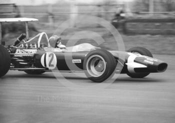 Jo Siffert, Rob Walker/Durlacher Lotus Ford 49B, on the way to 11th place, three laps down, Silverstone, International Trophy 1969.